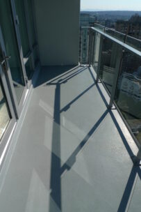 vancouver apartment balcony cleaning company performing window cleaning